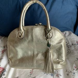 Gold colored leather purse